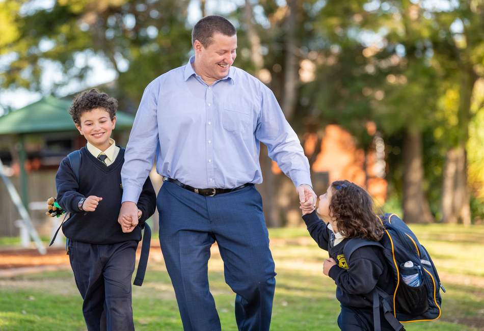 Sydney Catholic Schools Road Safety Education Officer, Andrew Sortwell, walking his children to school.